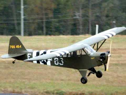 Tony Farmer flies his RC model L-4 Cub on its third flight