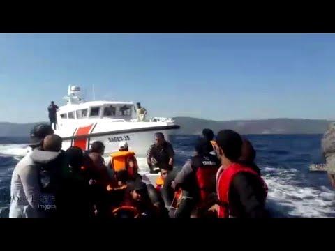 Turkish coast guard against refugee boat in Aegean Sea