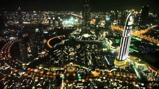 Burj Khalifa Dubai helicopter flight by night.