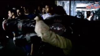 فيديو| لحظة إخراج الأقمشة من محلات الغورية بعد الحريق