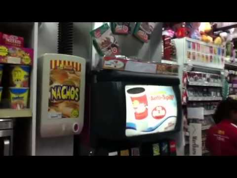 Buying things in 7 Eleven shop in Singapore