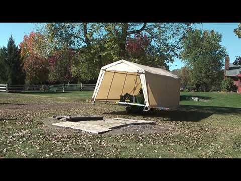 John Deere 1025R Loader Backhoe Move The ShelterLogic AutoShelter