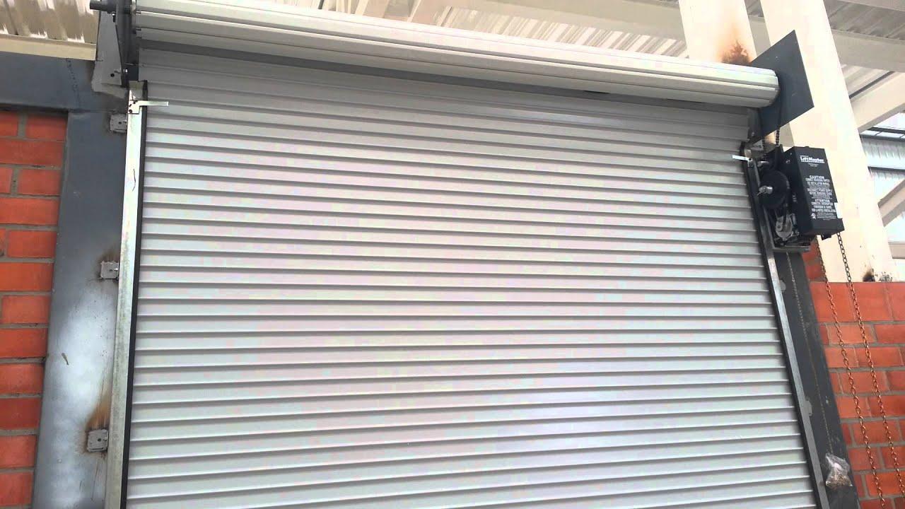 Puertas enrollables para muelles de carga youtube for Puertas de garaje precios