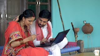 Indian village couple doing card payment using laptop - online shopping concept
