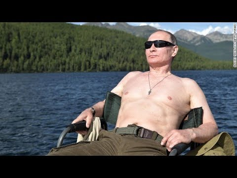 Putin sunbathes on vacation