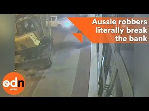 Crikey! CCTV footage shows daring Aussie robbers literally break the bank using construction digger
