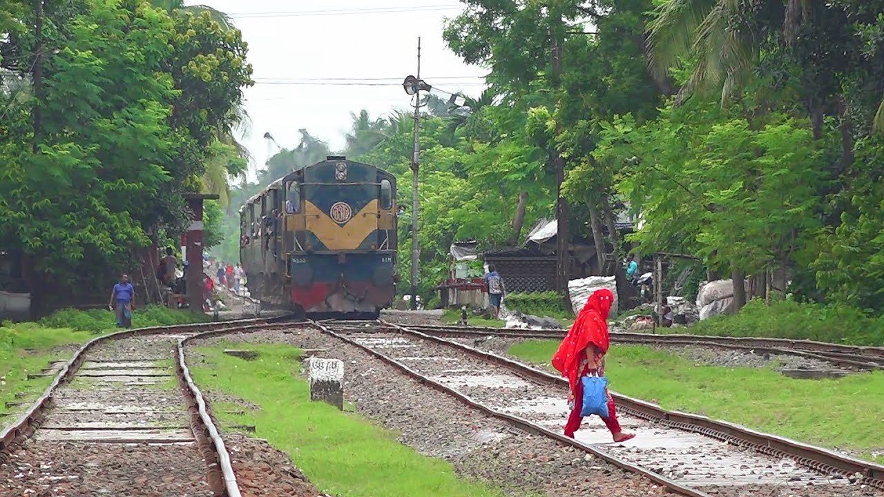 Risky Movement || Rocket Mail Train (Khulna-Chilahati) chased busy Rail line