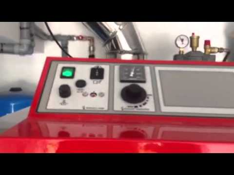 Instalaci n caldera atmos dc25sp combinada mixta le a - Caldera mixta lena pellet ...