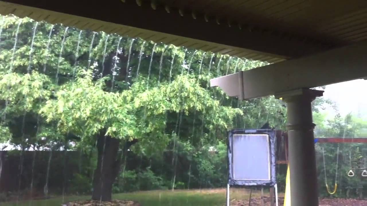 Adjustable Louvered Pergola in the rain.