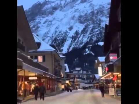 Amazing Evening Mountain View with Snow falls Grindelwald Switzerland Travel & Tourist Destination