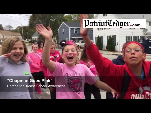 "Chapman Middle School students in Weymouth hold a ""Chapman Goes Pink for Breast Cancer Awareness"" pa"