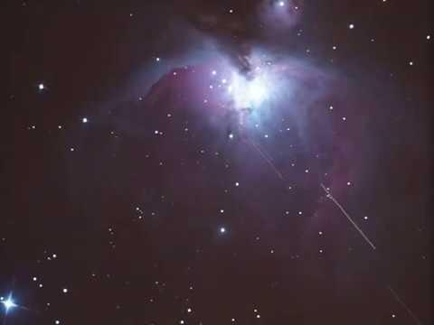 Geostationary satellites moving through  M42