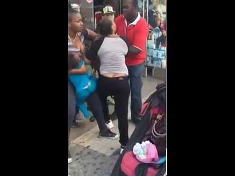 Shoplifter fights off store security w/ a baby in her arms