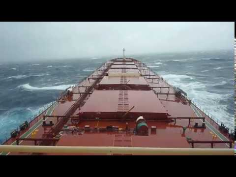 Bulk Carrier Ship Passing In Storm In Atlantic Ocean