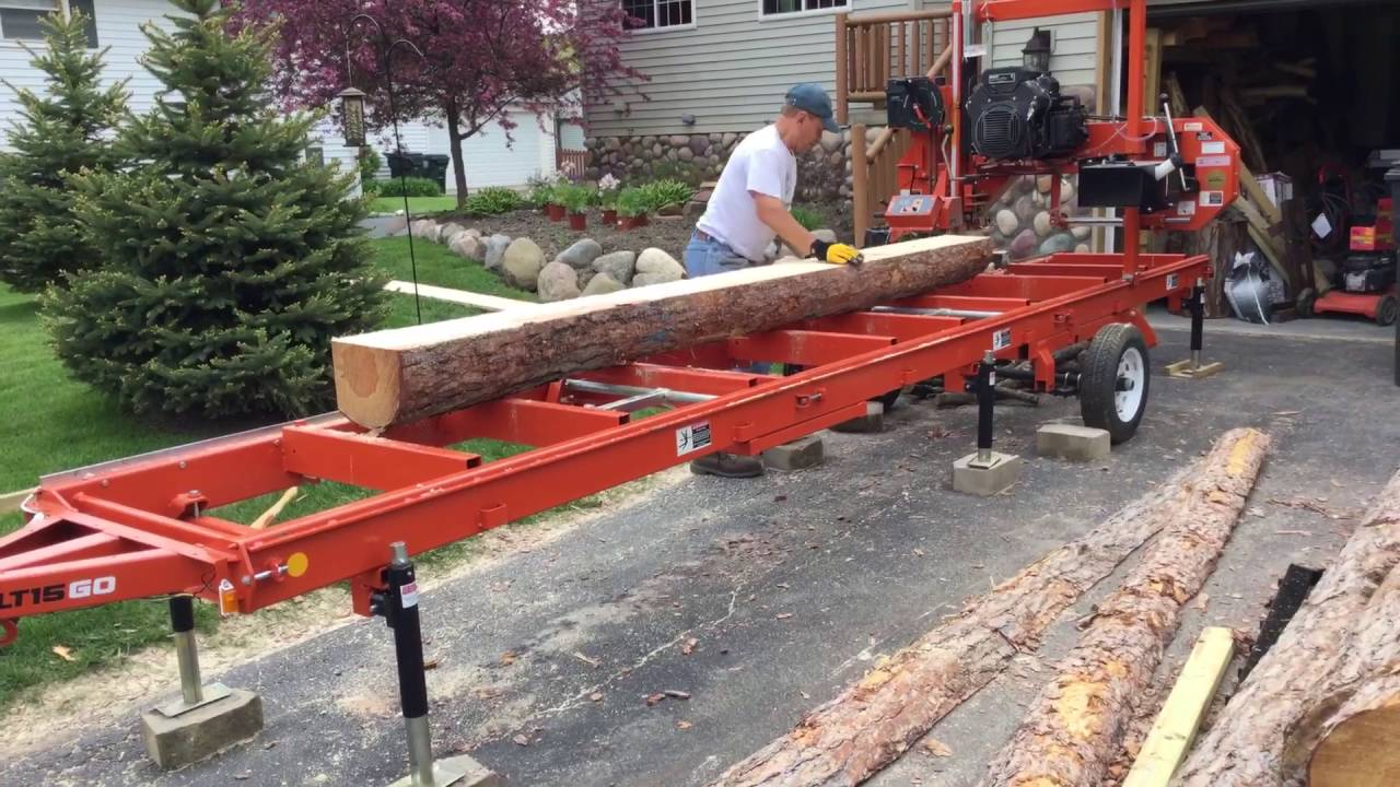 Woodmizer lt15go milling red pine log into live edge siding