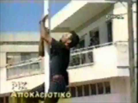 Turkish troops killing a Greek Cypriot demonstrator for trying to take down a flag