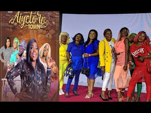 Download Funny! Funke Akindele With Her Aiyetoro Town Gals At Step Out In Multi-colour Dress At The Premiere