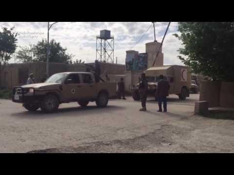 Afghan Soldiers' Coffins Transported After Balkh Base Assault