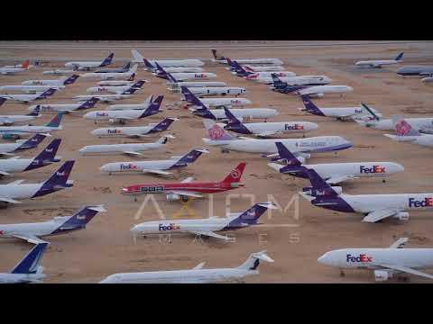 Orbiting FedEx Cargo Planes at an Aircraft Boneyard in the Desert at Sunset | AX0007_008