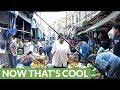 Market in Bangkok sets up shop right on active train tracks