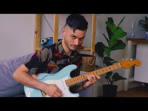 pretending to play guitar like Ben Eunson