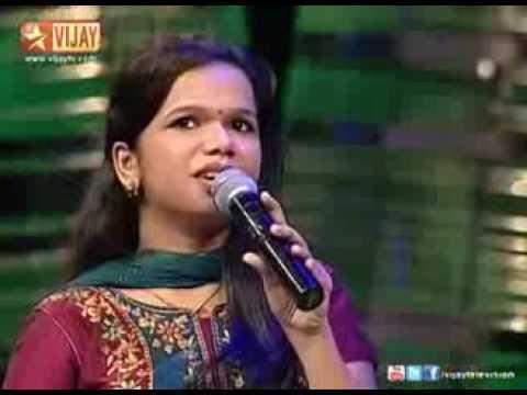 Parvathy sings poongaviyam