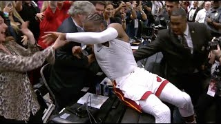D-Wade Trips While Jumping on Scorers Table After Final Miami Game, Swaps Jerseys w/ Teammates