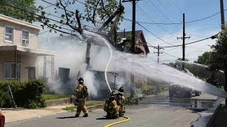 Tree trimming truck contacts power line truck fully involved with exposure to a house