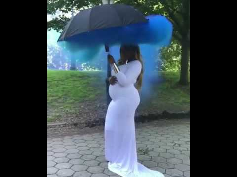 Pregnant Woman Does A Gender Reveal With Blue Smoke