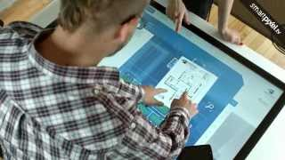 Multitouch application for real estate agents presented on an interactive table