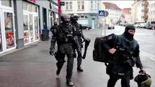 'Knifeman holds pregnant woman hostage' inside a refugee centre in Hamburg