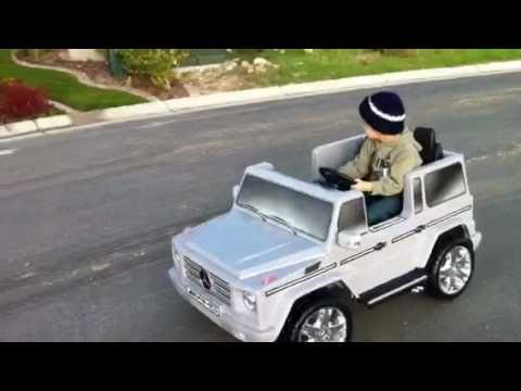 Toddler driving a mercedes benz g55 amg electric toy car for Mercedes benz toddler car
