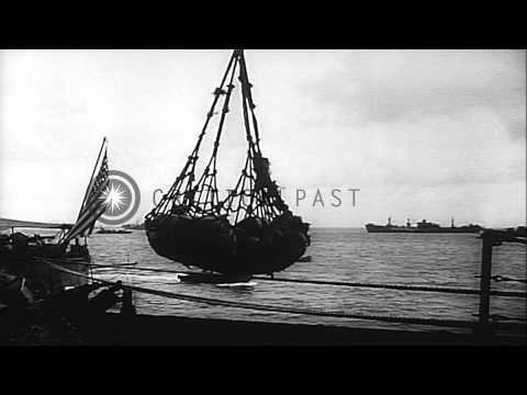 The US fleet of warships at anchor off Ulithi Atoll in World War II HD Stock Footage