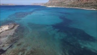 Drone flight over wonderful lagoon of Balos in Crete - Greece(Balos is one of the most beautiful beaches of Chania, but also at the whole world. Formed by a massive rock in the sea and connected to the mainland by a ..., 2016-01-06T19:12:38.000Z)