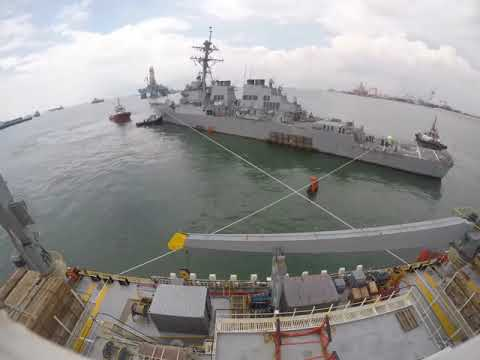 USS John S McCain Prepared Onload to MV Treasure.