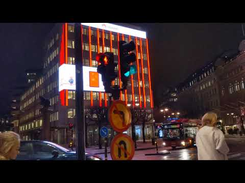 Elaborate LCD advertising display on 8 story building, central Stockholm, Sweden, 2019-12-11