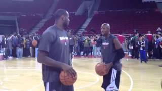 Ray Allen giving some tips to Lebron James on how to shoot pre game Beijing