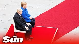 Boris Johnson given a military welcome in Germany by Angela Merkel