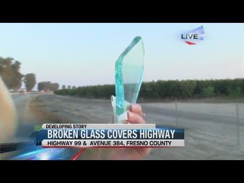 Truck Loses Glass Load On Highway Backing SB 99 Up For Miles