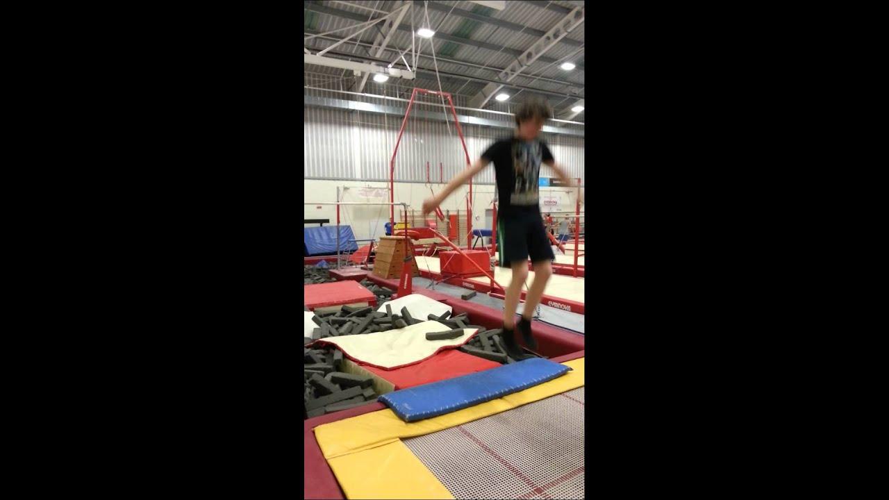 how to do a backflip twist on trampoline