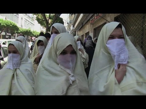 Women in white march to defend Algeria tradition