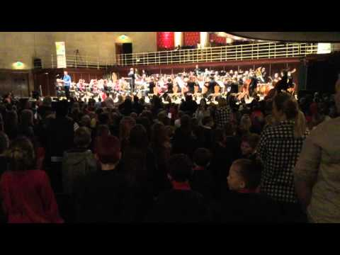 Sheffield school children singing with the Halle Orchestra