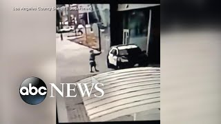 Man opens fire on 2 Los Angeles police officers sitting in a squad car