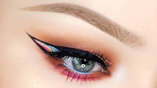 glittery peach summer eyes with rainbow liner