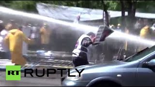 Video: Tear gas, water cannon as protesters break police barricade in Turkey