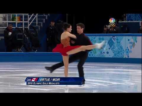 Tessa Virtue and Scott Moir kiss during Sochi 2014 FD warmup