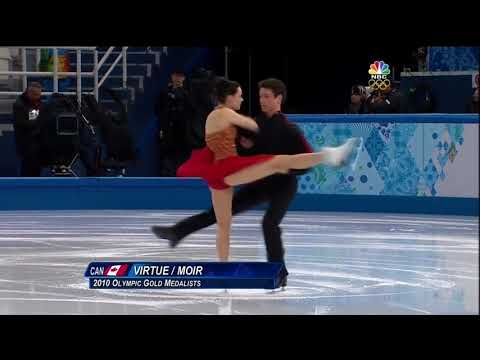 Tessa Virtue and Scott Moir kiss during Sochi 2014 FD warmup