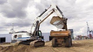 Liebherr R970 Super Mass Excavator Loading Volvo A35 Dumpers With Sand