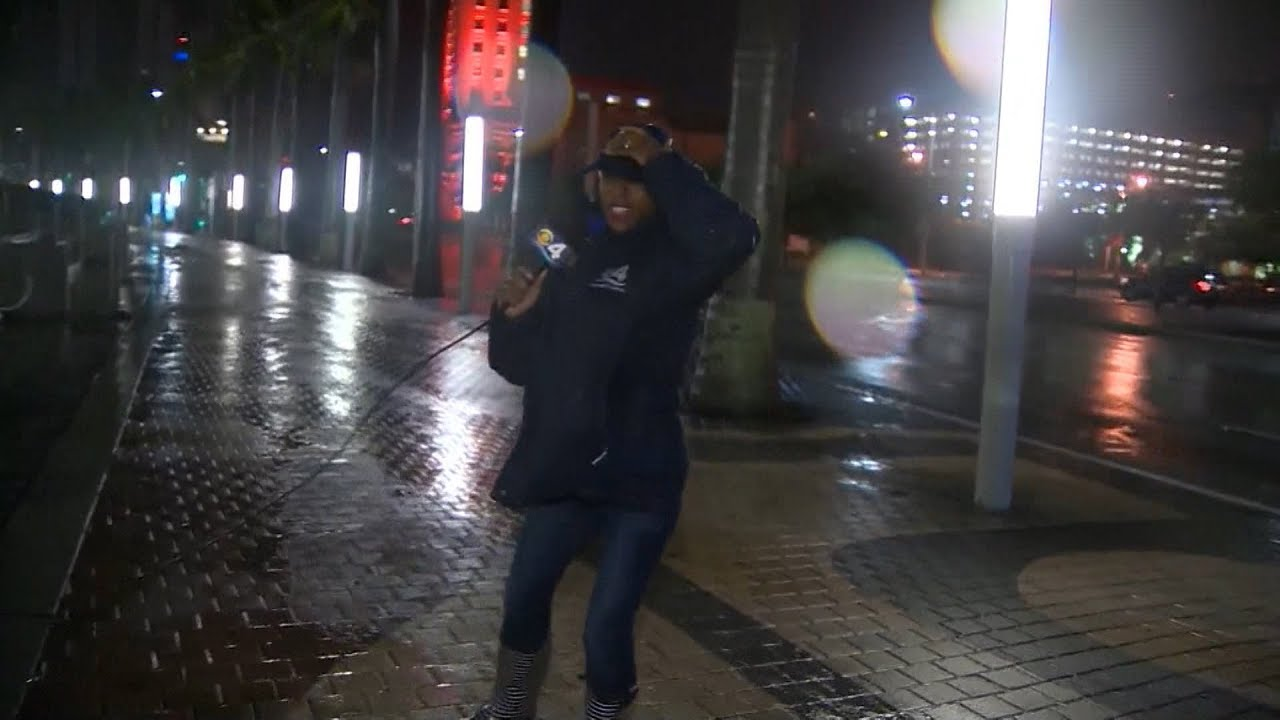Weather Channel reporter dodges falling glass