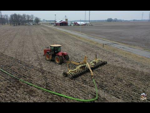 Manure Application With A Versatile 400 Tractor And Bazooka Farmstar Toolbar.